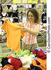 woman with shirt in shop