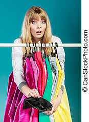 Woman with shopaholic problems. - Pretty woman with empty...