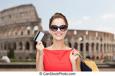 woman with shopping bags and credit card in rome