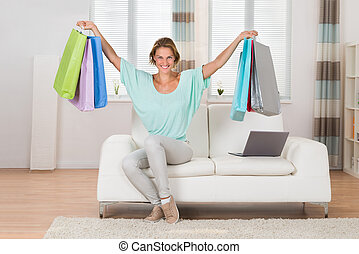 Woman With Shopping Bags At Home