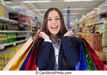 woman with shopping bags at the supermarket