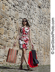 Woman with Shopping Bags in a City