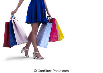 Woman with shopping bags in hand. Isolated on white background