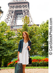 woman with shopping bags in Paris