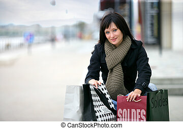 Woman with shopping bags in the street