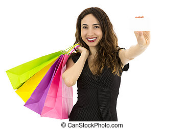 Woman with shopping bags presenting a blank sign card
