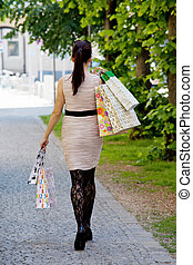 Woman with shopping bags while shopping