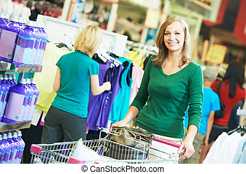 woman with shopping cart at supermarket
