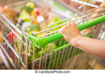 Woman with shopping cart.