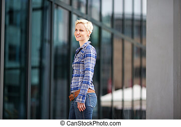 woman with short blond hair in the city