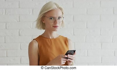 Woman with short hair using smartphone - Pretty young female...