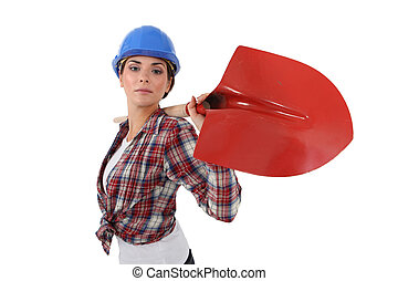 Woman with shovel over his shoulder