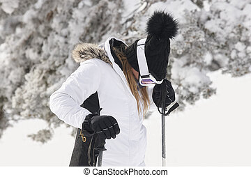 Woman with ski equipment on snow. Winter time