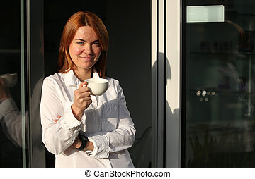 Woman with skin problems holding cup