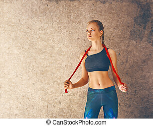 Woman with skipping rope.