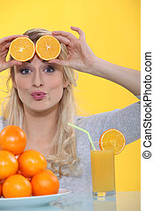Woman with slices of orange on the forehead