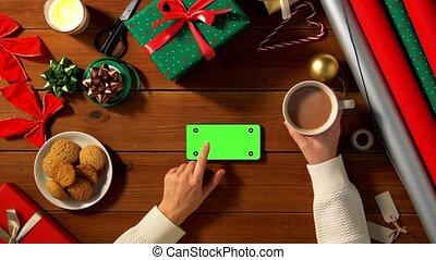 woman with smartphone and coffee on christmas - christmas, ...