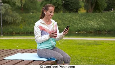 woman with smartphone and shake listening to music -...