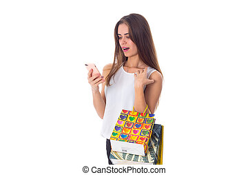 Woman with smartphone and shopping bags