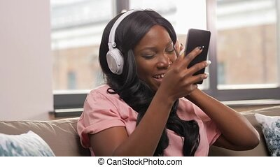 woman with smartphone listening to music at home - people, ...