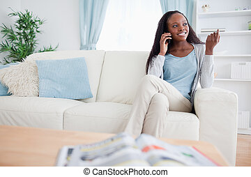 Woman with smartphone on sofa