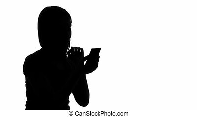 Woman with smartphone - Silhouette of a woman with...