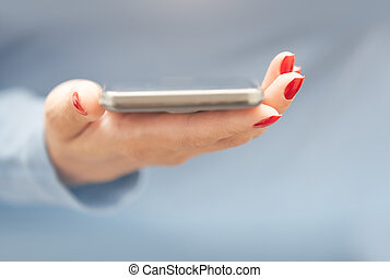 Woman with smartphone - Woman with red manicure with...