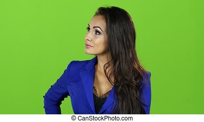 Woman with smile talking on mobile phone, green screen background