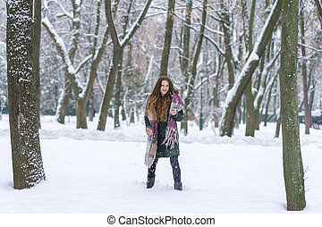 woman with snow in the park