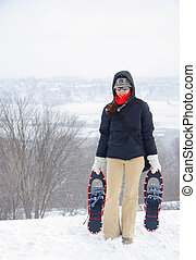 Woman with snowshoes