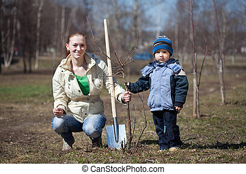 woman with son replanting tree