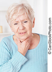 Woman with sore throat - Older sick woman with sore throat