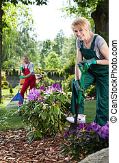 Woman with spade in garden