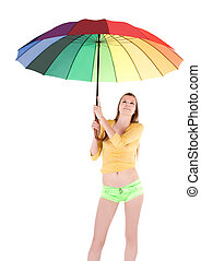 Woman with spectrum umbrella over white