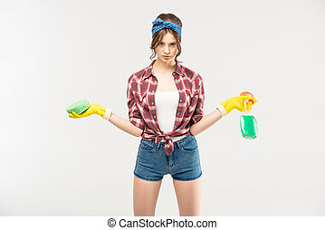 Woman with sponge and spray bottle - Beautiful young...
