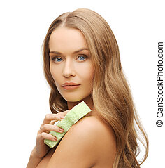 woman with sponge - bright picture of beautiful woman with...