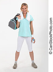Woman with sports bag over shoulder