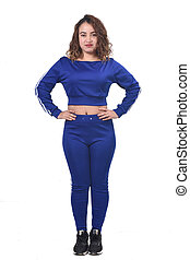woman with sportswear arms on hip on white background,