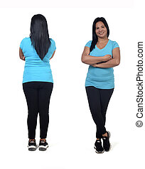 woman with sportswear front and back on white background, arms crossed