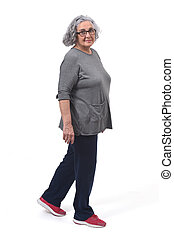 woman with sportsweare walking on white background