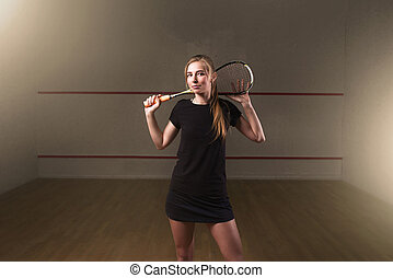 Woman with squash racket, indoor training club - Attractive...
