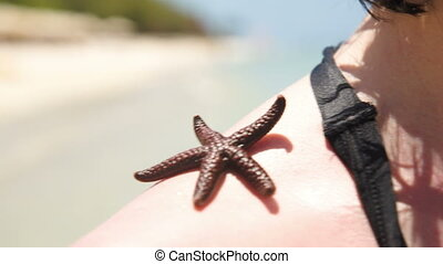 woman with starfish on shoulder