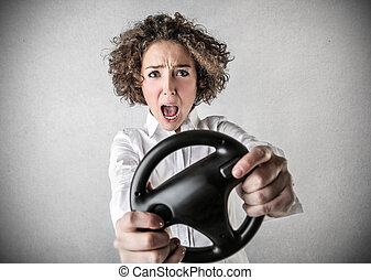 Woman with steering wheel - Woman holding steering wheel