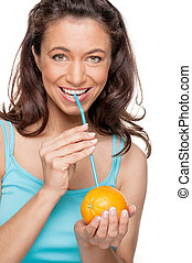 Woman with straw and orange