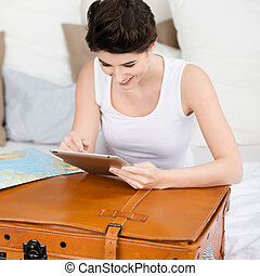 Woman With Suitcase Searching For Travel Destination On Digital