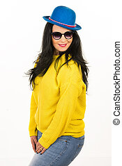 Woman with sunglasses and blue hat