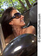 Woman With Sunglasses Driving Convertible