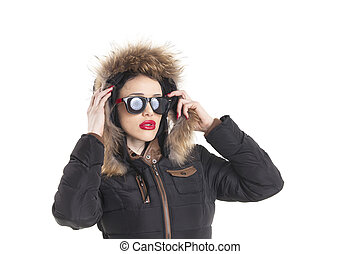 woman with sunglasses in a winter coat
