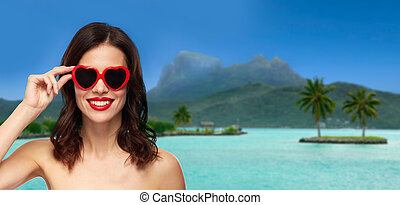 woman with sunglasses over bora bora beach