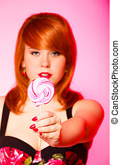 Woman with sweet candy lollipop in hand.